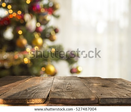 christmas table background with christmas tree out of focus