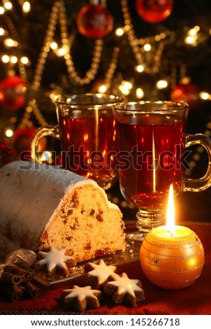 Christmas table - cake, cookies, candles and christmas decorations