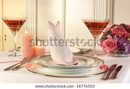 Christmas table decorated with pastel pink candles and flowers