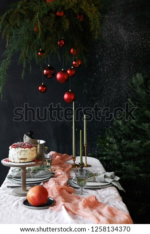 christmas table decoration with homemade cake and spruce composition with christmas toys, dark atmosphere, cozy atmosphere #1258134370