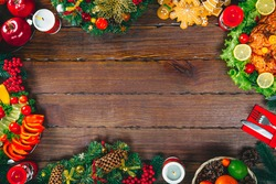 Christmas table dinner time with roasted meats decorated in Christmas style. Background thanksgiving. The concept of a family holiday, delicious food. Frame with free space.
