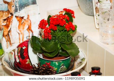 Christmas table, festive Christmas table setting, elegant dishes, Christmas houses and candles. Beautiful decor.