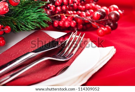Christmas table layout, multi-colored tape with a branch of berries