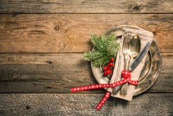 Christmas table place setting on wooden background, top view with copy space. Holidays background