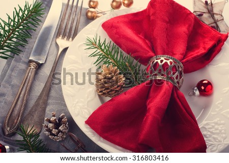 Christmas table place setting with christmas decorations. Christmas menu concept. Retro style toned.