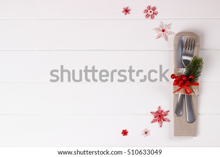 Christmas table setting on white wooden table.Christmas card template