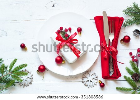 Christmas Table Setting With Christmas Decorations And Gift At White