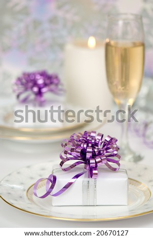 Christmas table setting with presents and champagne - purple theme