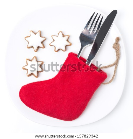 Christmas table setting with red boots and cookies, isolated on white