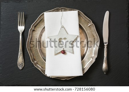 Christmas table setting with vintage dishware, silverware and star decorations. Top view. Christmas decorations. #728156080