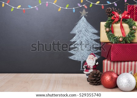 Christmas table with decorations and gift box on christmas tree background. #529355740