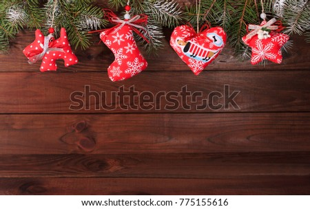 Christmas textile decoration on a wooden background. Greeting card. Greeting card. #775155616