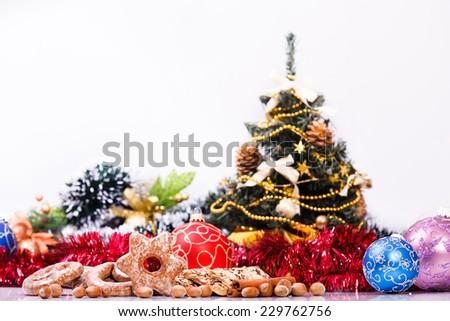 Christmas theme of cookies, christmas balls and decorations. Selective focus on cookies and christmas balls