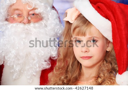 Christmas theme: Santa claus with a cute little girl.