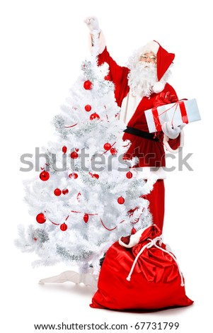 Christmas theme: Santa Claus with presents and christmas tree. Isolated over white background.