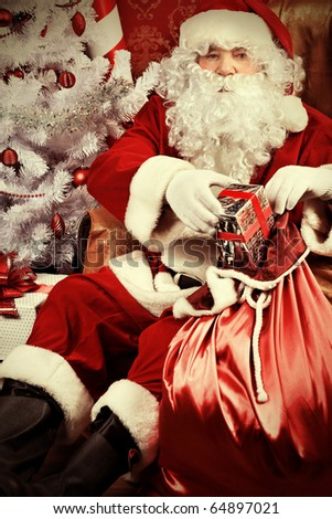 Christmas theme: Santa gifts, ina a interior.