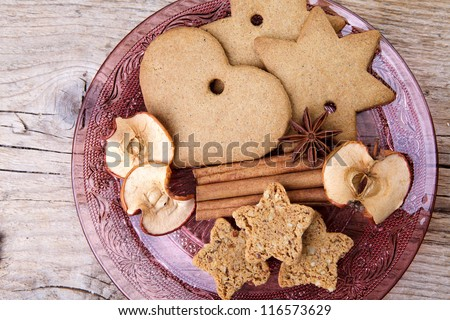 Christmas theme Still-Life with Gingerbread and Cinnamon Star Cookies and Spices on glass plate