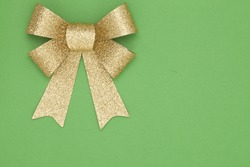 Christmas themed background with green background and bow