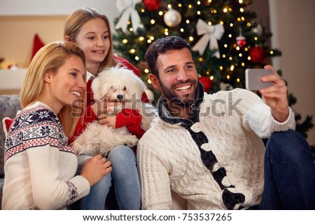 Christmas time family self-portrait- young smiling family