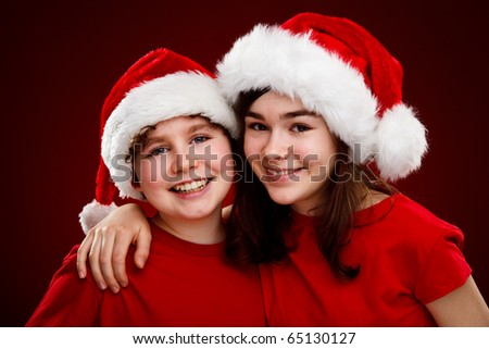 Christmas time - kids with Santa Claus Hat - stock photo