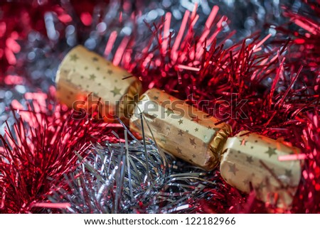 Christmas Tinsel & Christmas Crackers in red, gold & silver.