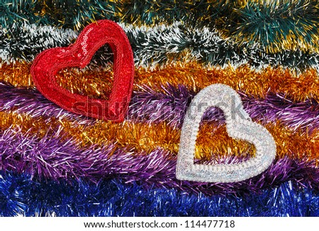 Christmas tinsel multicolored decoration with two hearts