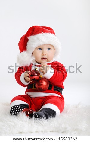 Christmas toddler in Santa hat - stock photo