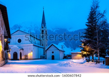 Christmas town Livigno in winter, evening, when everything shines and shines. Popular ski resort in Lombardy, Italy.