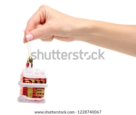 Christmas toy house in hand on a white background isolation #1228740067