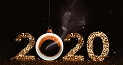 Christmas toy is made from a fragrant cup of coffee. Holiday concept. Fragrant coffee on a red background for your advertising. Smoke from hot coffee. The numbers 2020 are written from sparkles. Templ