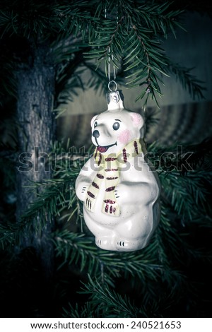 Christmas Toy Polar Bear with scarf hanging on the Christmas tree