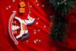 Christmas toy rocking horse on red velvet