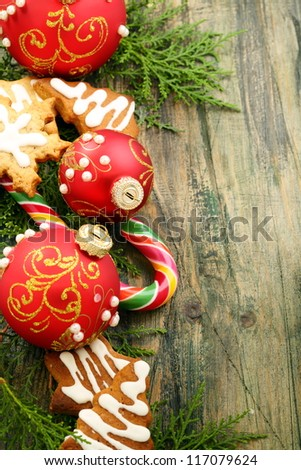 Christmas toys, sweets and cakes on a wooden table.