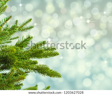 Christmas tree against blue sparkling background. #1203627028