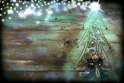 Christmas Tree and Angel in rustic wooden background
