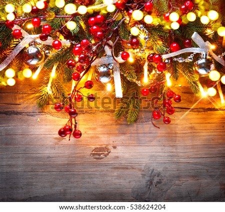 Christmas Tree And Decorations Over Wooden Background New Year Baubles Light Garland Old