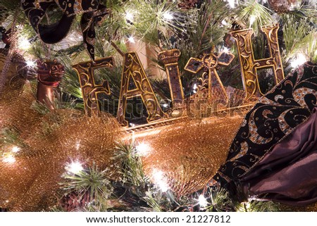 Christmas tree and decorations with the word FAITH