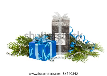 Christmas tree and festive gift boxes with ribbons isolated on white background