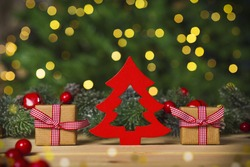 Christmas tree and gifs, wooden floor, lights background
