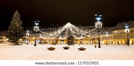 Christmas tree and lights in old town square in Sibiu Transylvania Romania