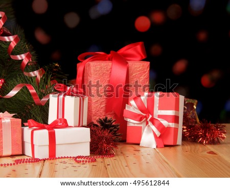 christmas tree and many gifts on abstract dark background - How Many Gifts For Christmas