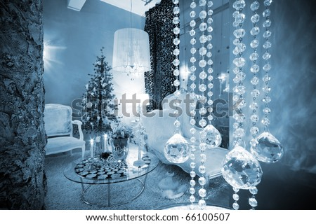 Christmas tree at the window in a modern apartment