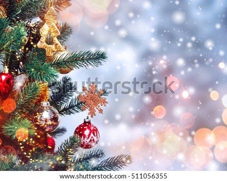 Christmas tree background and Christmas decorations with snow, blurred, sparking, glowing. Happy New Year and Xmas theme #511056355