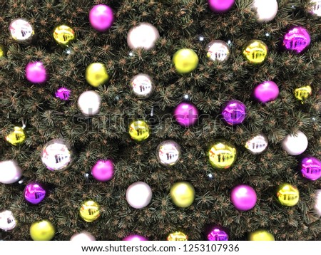 Christmas tree baubles on a large Christmas tree, Pink baubles, Yellow baubles and Silver baubles #1253107936