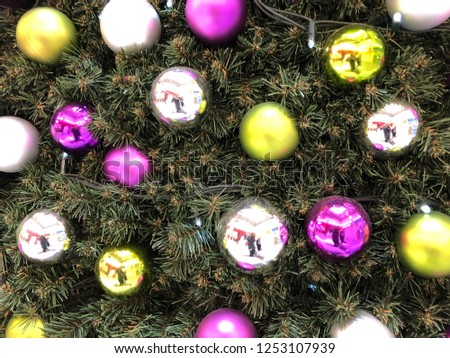 Christmas tree baubles on a large Christmas tree, Pink baubles, Yellow baubles and Silver baubles #1253107939