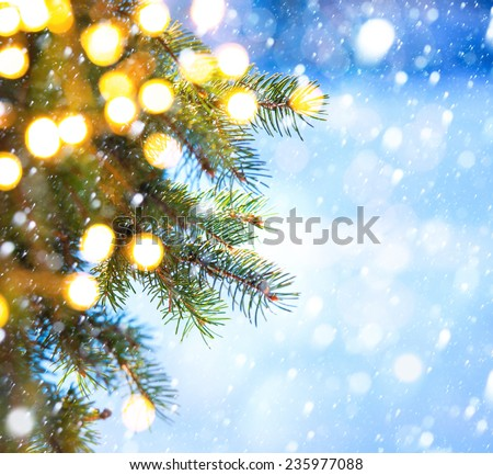 Christmas tree branch on a blue background - Shutterstock ID 235977088