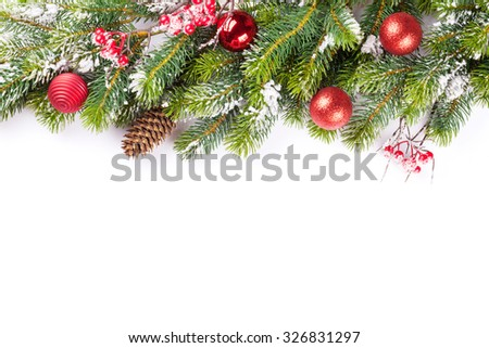 Christmas tree branch with snow and baubles. Isolated on white background with copy space #326831297
