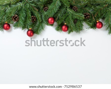 Christmas tree branches and ornaments on white background. Plenty of copy space available.  #752986537