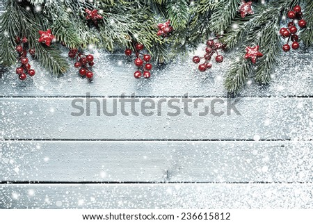 Christmas tree branches on wood background #236615812