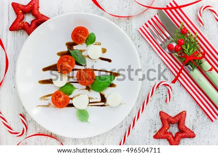 Christmas tree caprese salad, festive appetizer. Christmas table setting concept top view